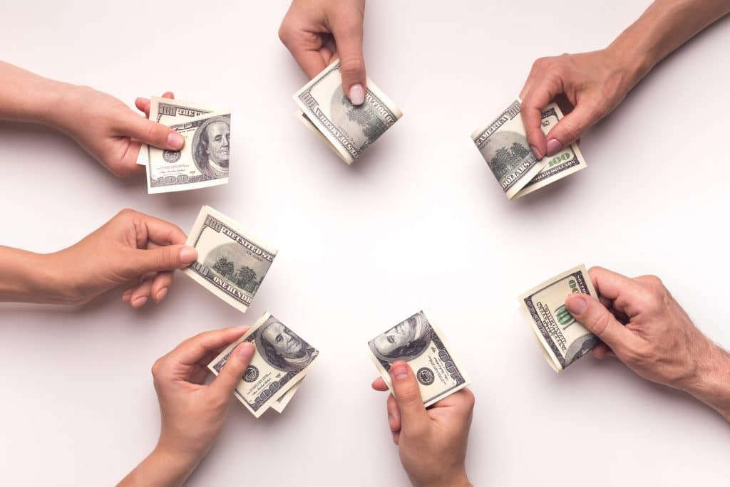 crowdfunding hands pooling cash collecting money